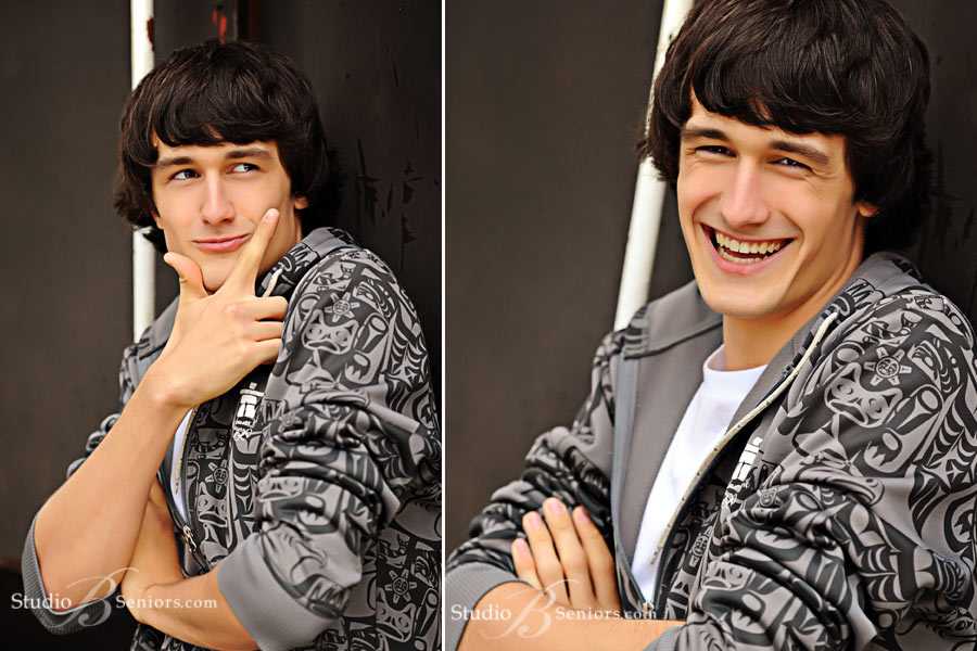 Great-boy-senior-pictures-of-Eastsdie-Catholic-High-School-guy-laughing-near-train-at-Studio-B-in-Issaquah