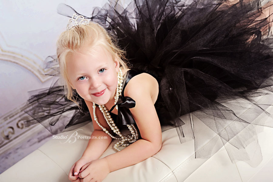 Little-girl-dressed-in-black-tutu-in-Breakfast-at-Tiffanys-theme-for-Studio-B-Portraits