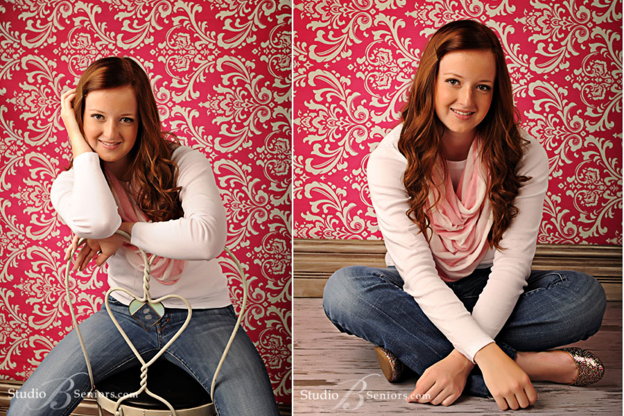 Pretty-red-head-high-school-senior-from-Kirkland-smiling-against-pink-damask-background