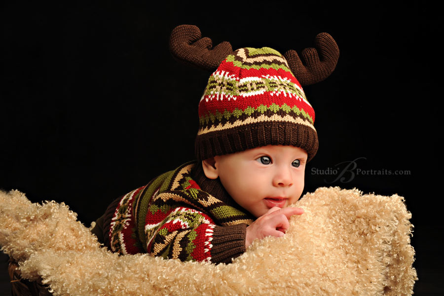 Baby-boy-in-reindeer-hat at Studio B Portraits near Seattle