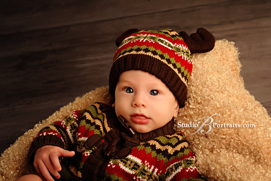 Cute-baby-boy-in-reindeer-hat-at-Studio-B-Portraits-near-Seattle