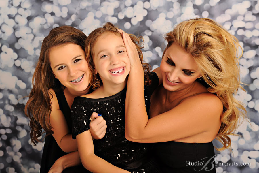 Great-family-pictures-of-beautiful-Mom-with-daughters-laughing-at-Studio-B-near-Bellevue-WA