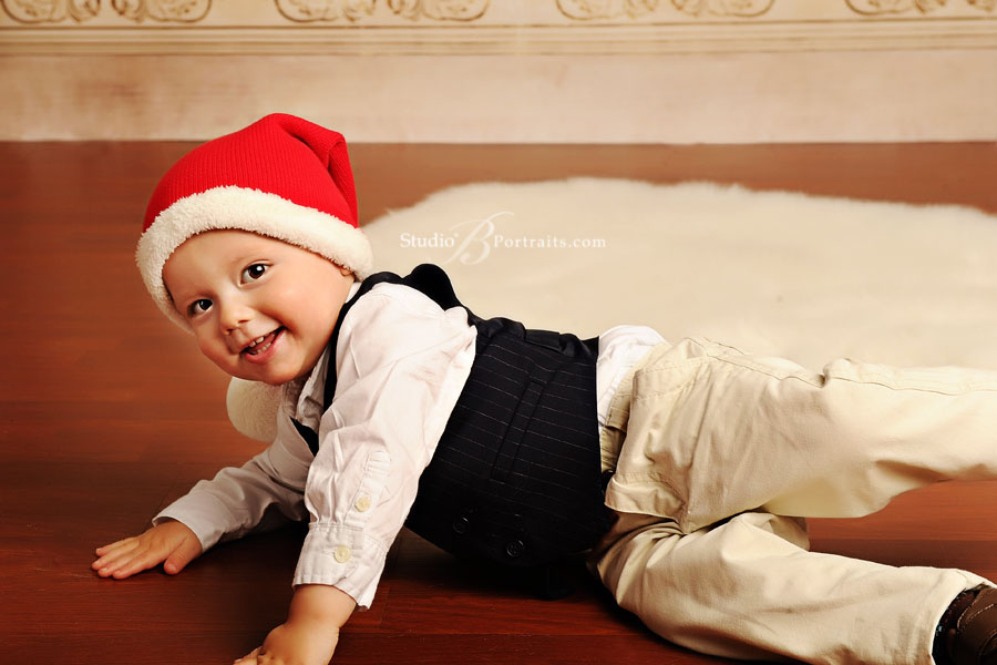 Cute-baby-boy-in-Santa-Hat-during-holiday-family-pictures-at-Studio-B