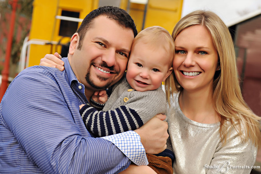 Cute-outdoor-family-picture-of-Kirkland-Mom-and-Dad-with-baby-at-Studio-B-Portraits