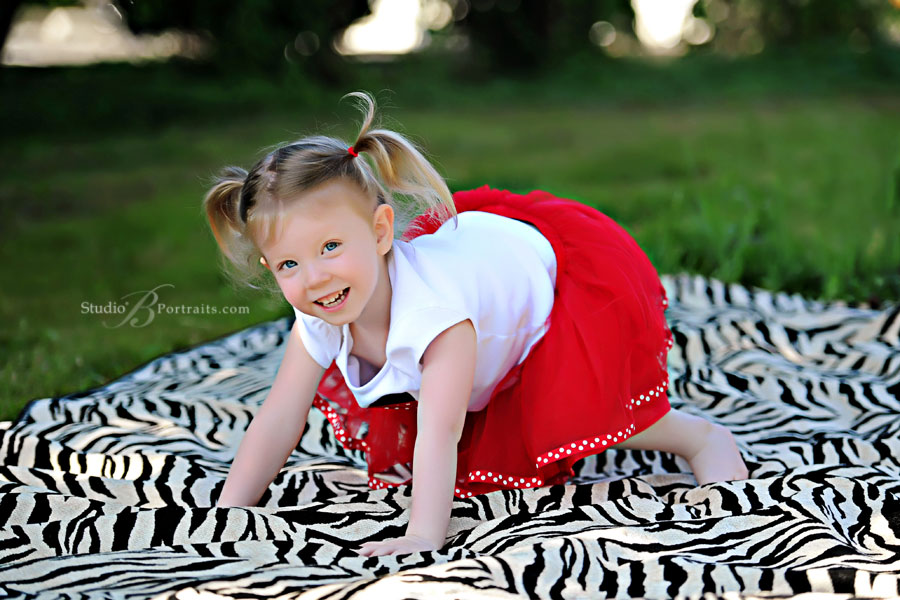 Great-childrens-pictures-of-3-year-old-on-zebra-blanket-with-tutu-at-Studio-B-Portraits