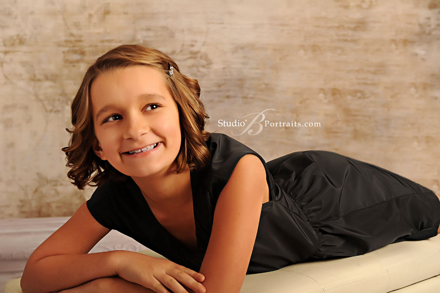 Pretty-little-girl-in-black-dress-during-family-portraits-at-Studio-B-in-Issaquah_2