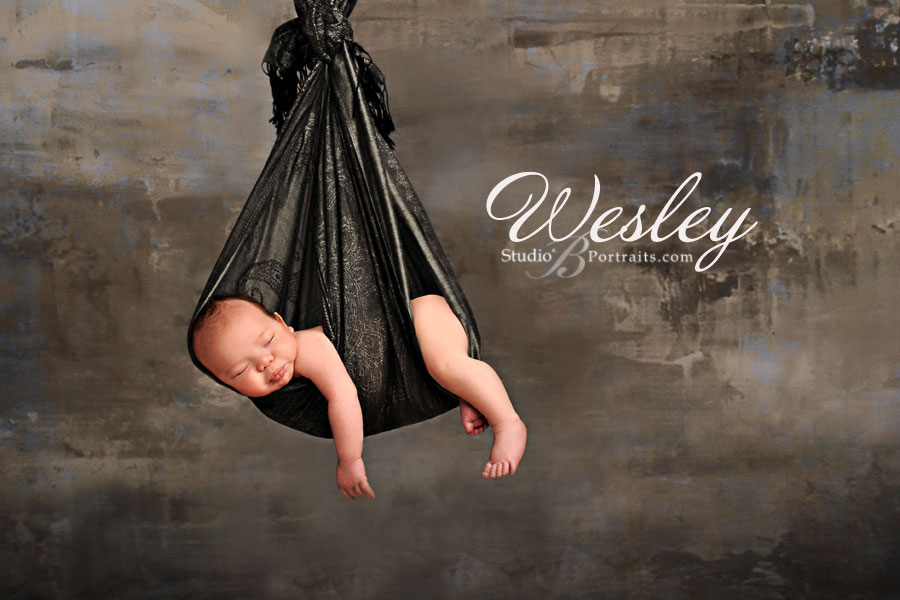 Studio-B-Portraits_best-newborn-portraits-of-boy-in-stork-sling-sleeping