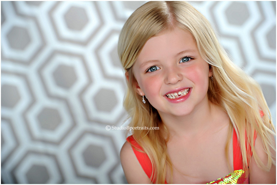 Best childrens photographer_4 year old blonde in modern glitter dress