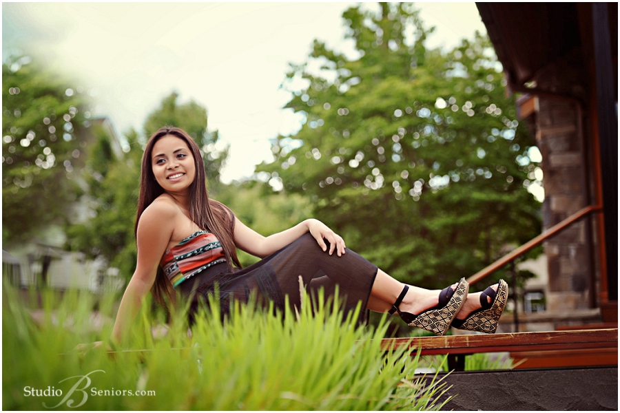 Best Girl Senior Pictures wearing pretty black dress in the grass_Studio B Portraits_0010.jpg