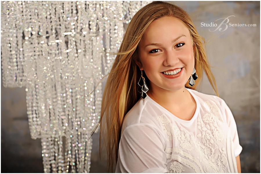 Blonde girl in lace black shorts and white shirt in front of Chandelier_Senior Pictures_Studio B_0016.jpg
