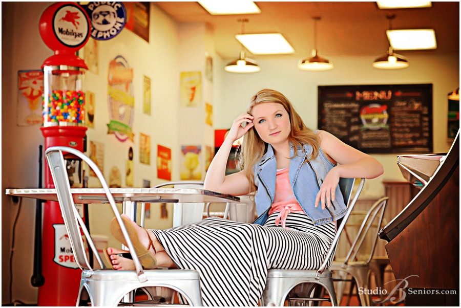 Magazine style senior piictures of girl with juke box and gumball machine