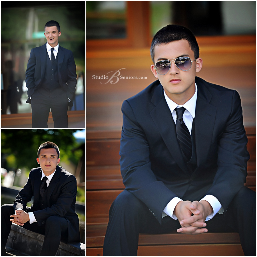 Senior guy in black suit and tie outdoors during senior pictures_Studio B_0018.jpg