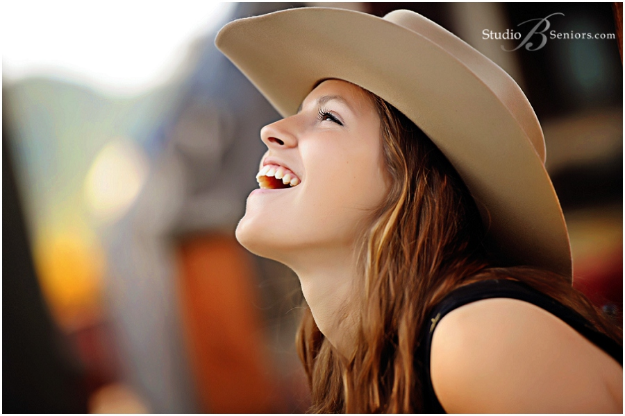 Bellevue Senior Pictures of pretty girl in cowboy hat and star dress_StudioB_0064.jpg