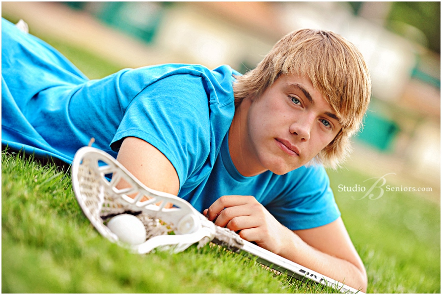 Lacrosse themed senior pictures of boy in blue shirt__Brooke Clark_Studio B Portraits_0100.jpg