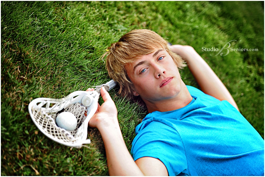 Lacrosse themed senior pictures of boy in blue shirt__Brooke Clark_Studio B Portraits_0101.jpg