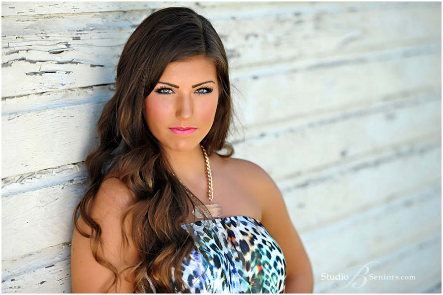 Outdoor senior pictures of girl in animal print dress__Brooke Clark_Studio B Portraits_0103.jpg