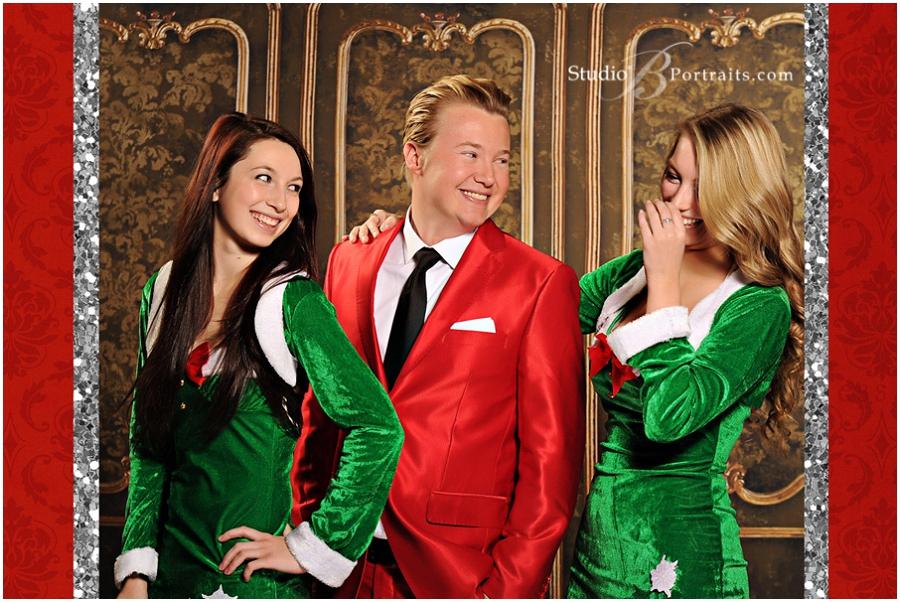 Modern guy in red Santa suit with hot model elves__Brooke Clark_Studio B Portraits_0177.jpg