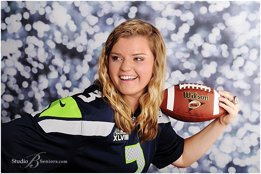 Senior girl in Seahawks jersey with Super Bowl Ring
