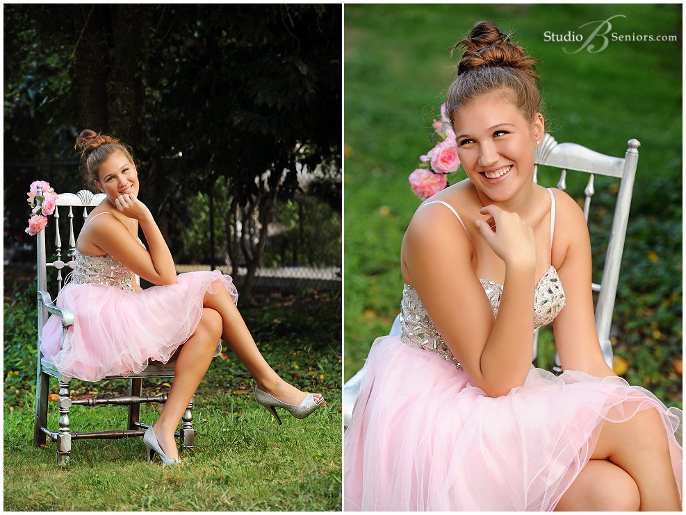 Senior pictures of girl in pink prom dress and bun outside_Studio B_0185.jpg