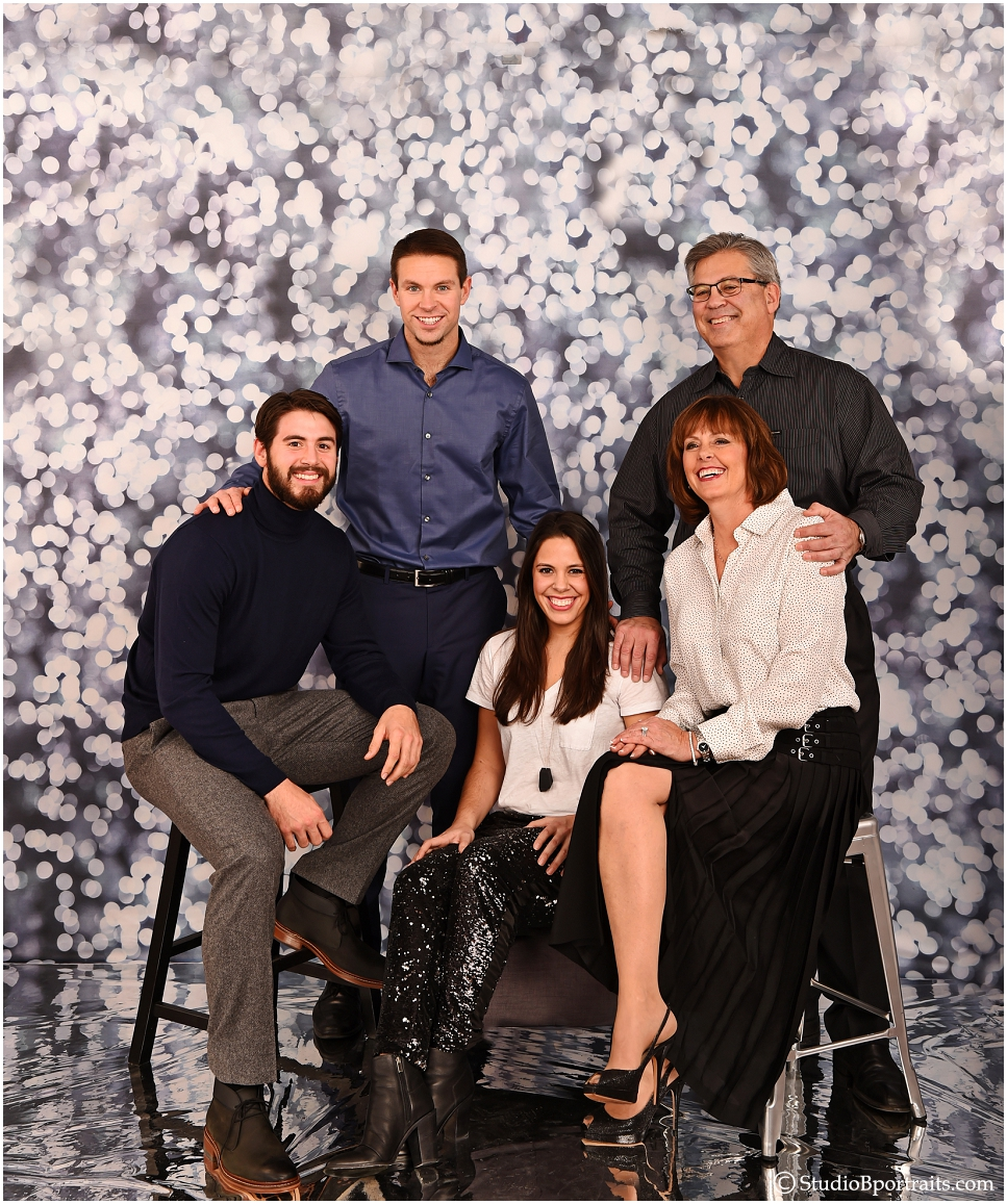 Fun family pictures on cool silver background at Studio B Portraits_0234.jpg