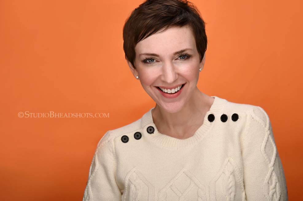 Science reveals that Headshots on bright backgrounds like orange are eye catching_Photographer Brooke Clark