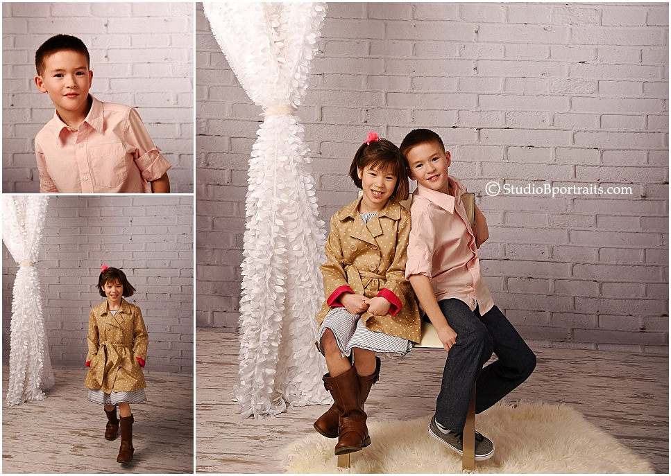 Best family portrait studio Seattle_young family in chic pink and navy against brick_0266.jpg