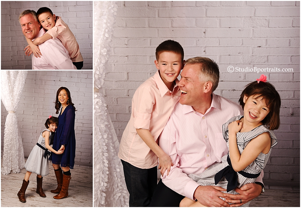 Best family portrait studio Seattle_young family in chic pink and navy against brick_0267.jpg