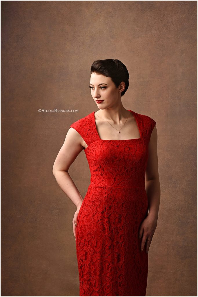 Best senior pictures of girl with with vintage style and old Hollywood glamour in red Mod Cloth dress