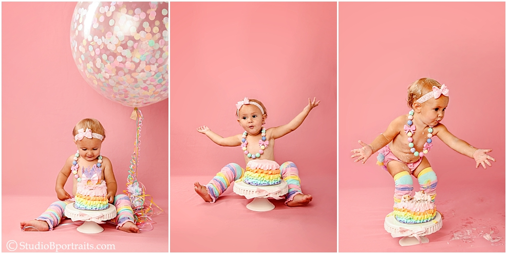 one year portraits with big confetti balloon and cake
