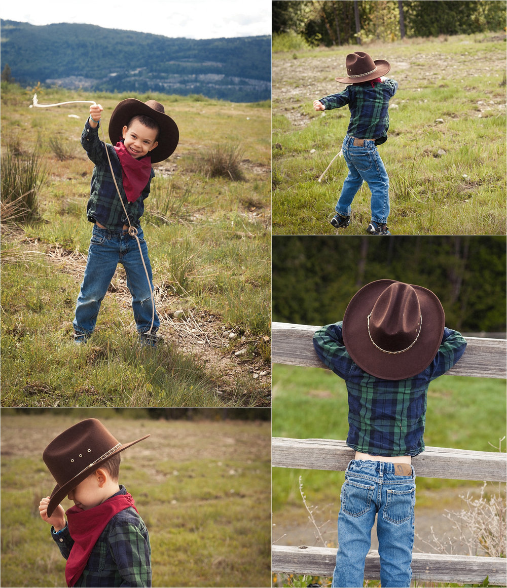 Cute four year old dressed as a cowboy swinging a rope and dancing in a field