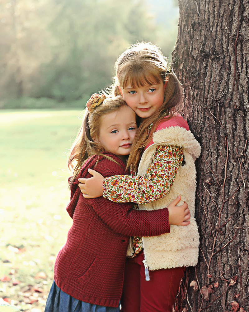 Studio B Portraits Fall family portrait of beautiful girls hugging near a large tree_Wadlow__7255v.jpg