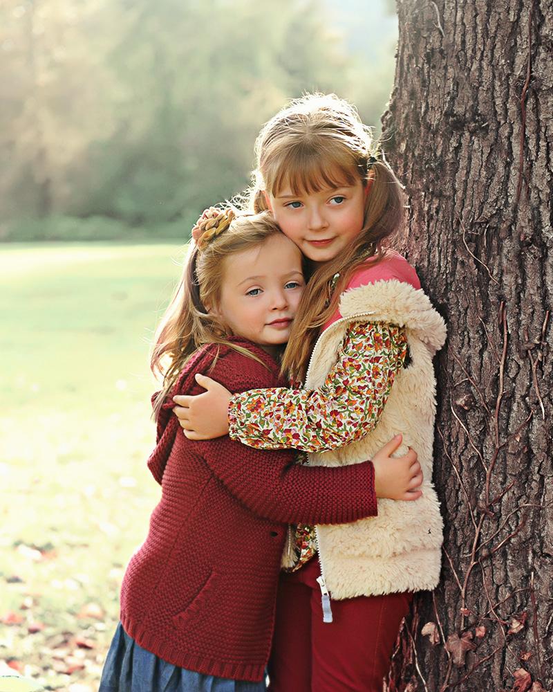 Studio B Portraits Fall family portrait of beautiful girls hugging near a large tree_Wadlow__7255v.jpg
