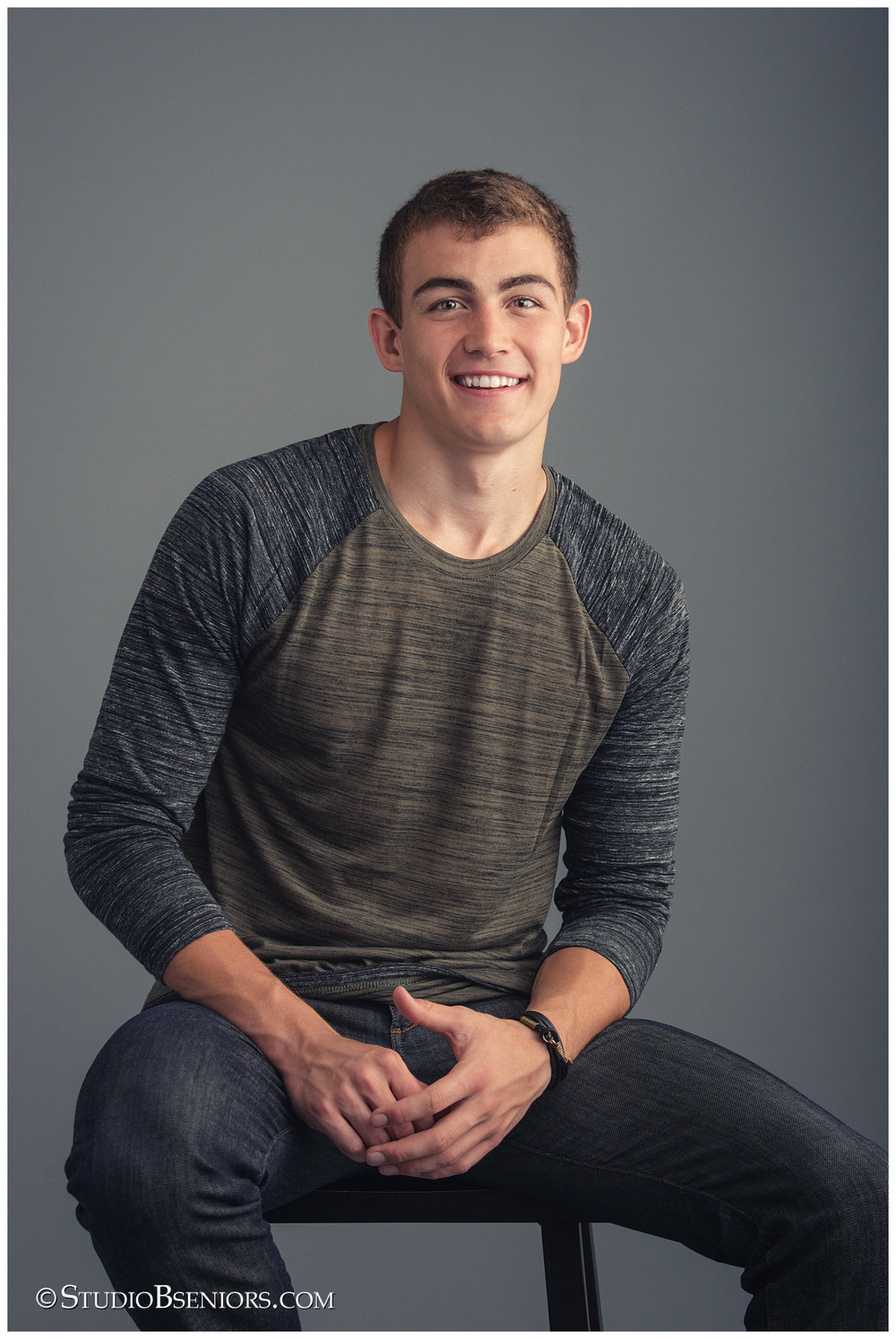 Great Senior Pictures of guy in studio wearing a henley_RoordaC_6848V.jpg