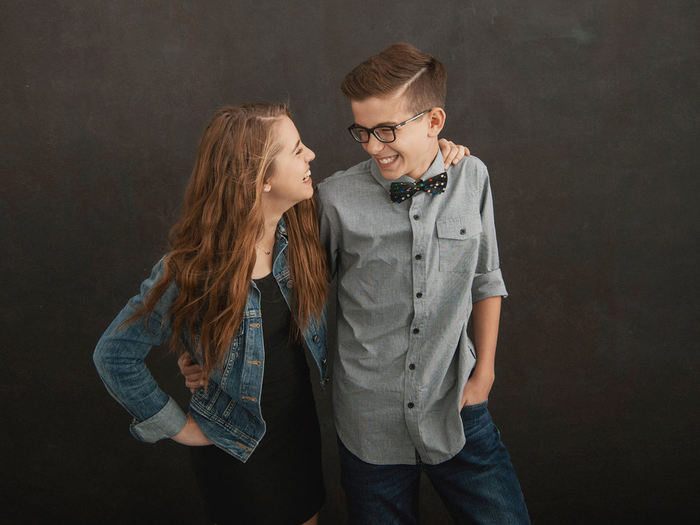 Brother and sister laughing_Studio B Portraits.jpg