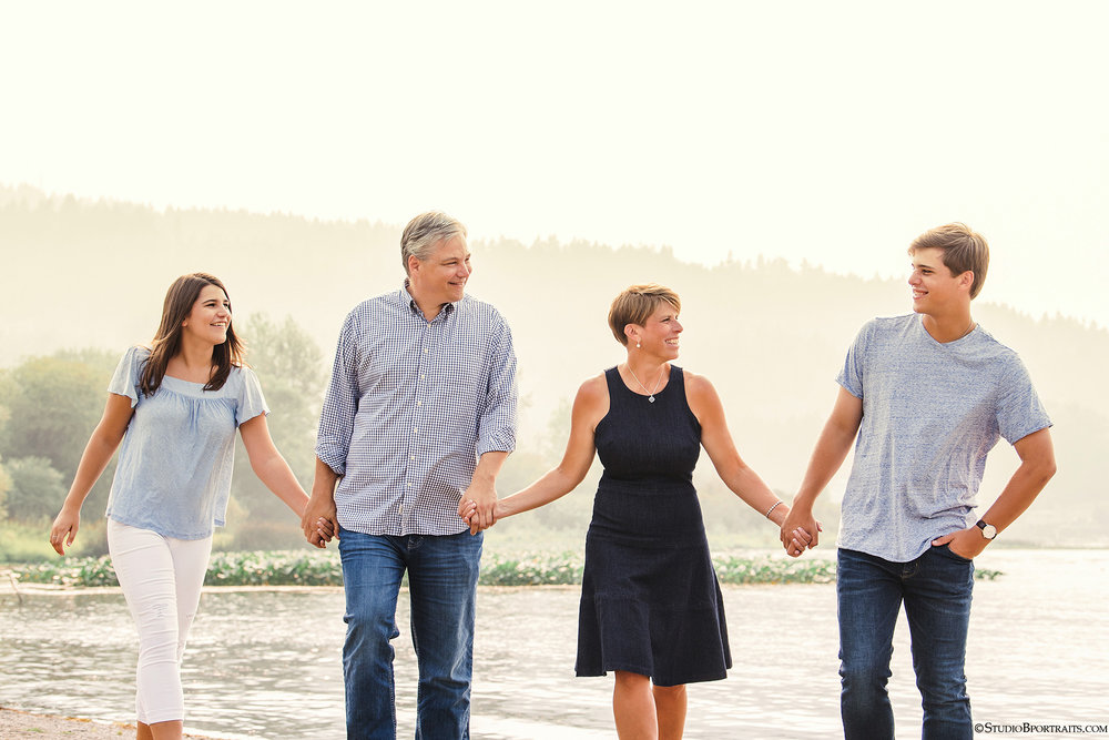 Best family photographer is Studio B Portraits_Bellevue family on beach walking and lauging.jpg
