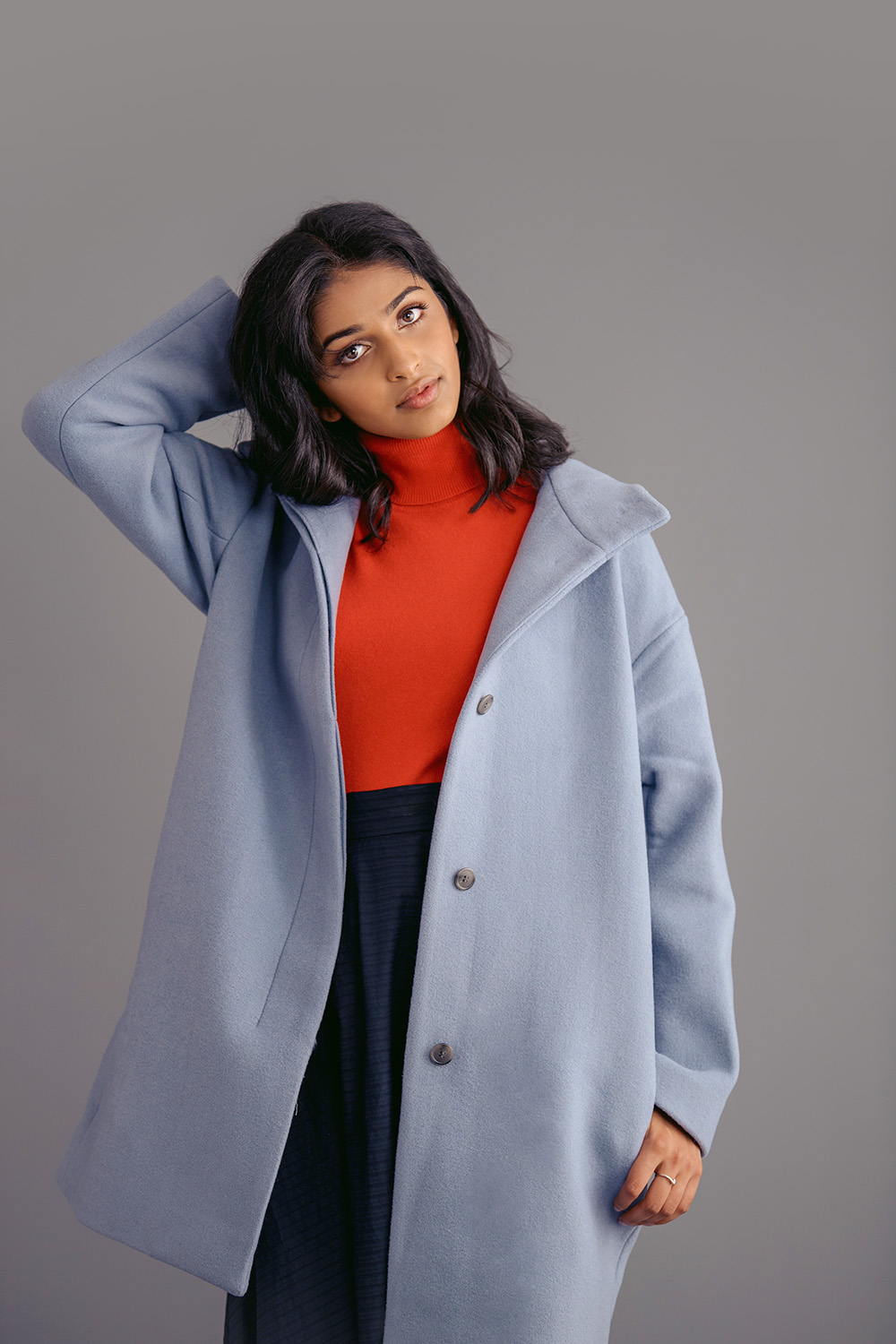 Studio B Portraits_pretty Indian girl in powder blu coat and red turtleneck_Lakshman_6831v.jpg