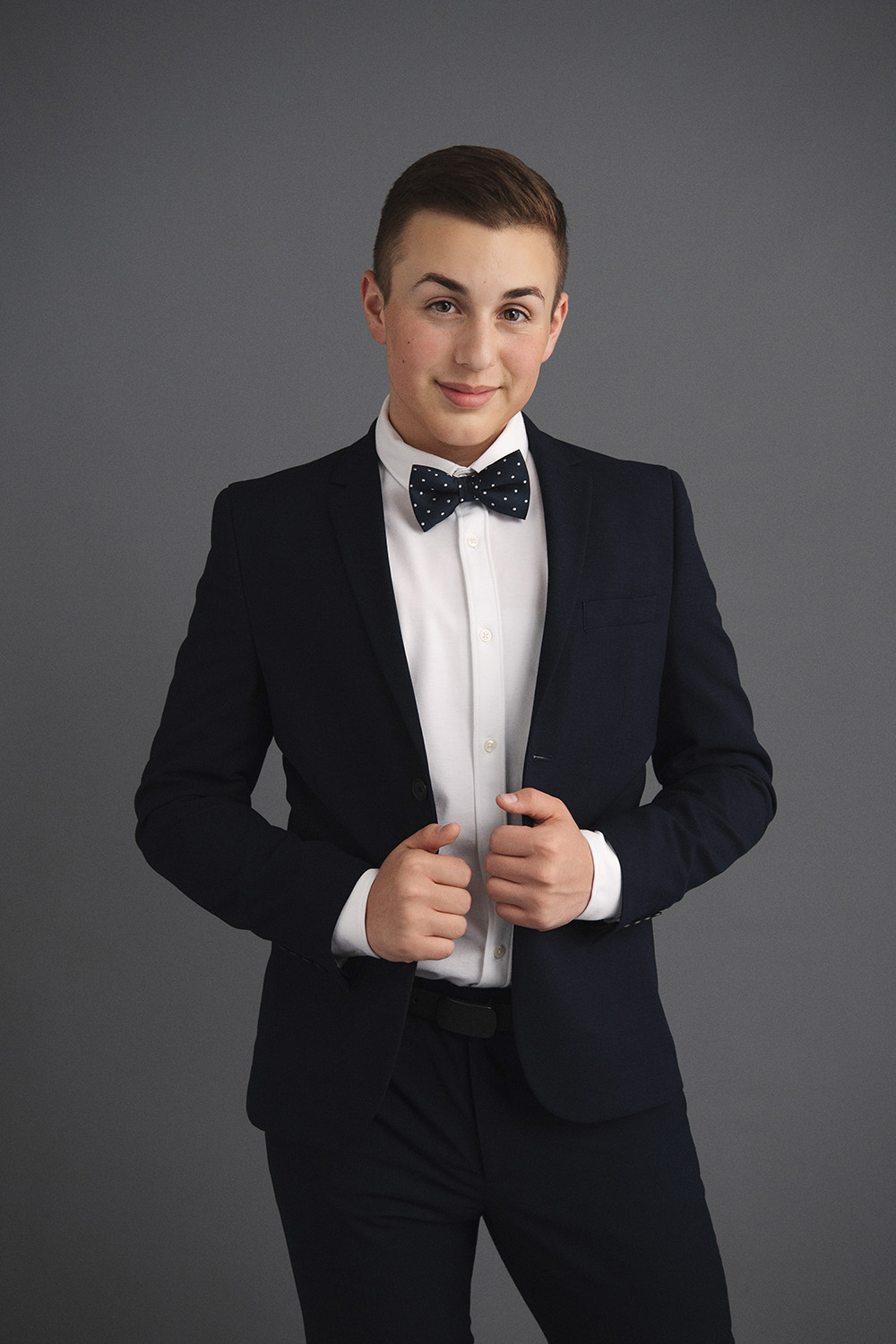Studio B Portraits_Handsome boy in suit and bowtie.jpg