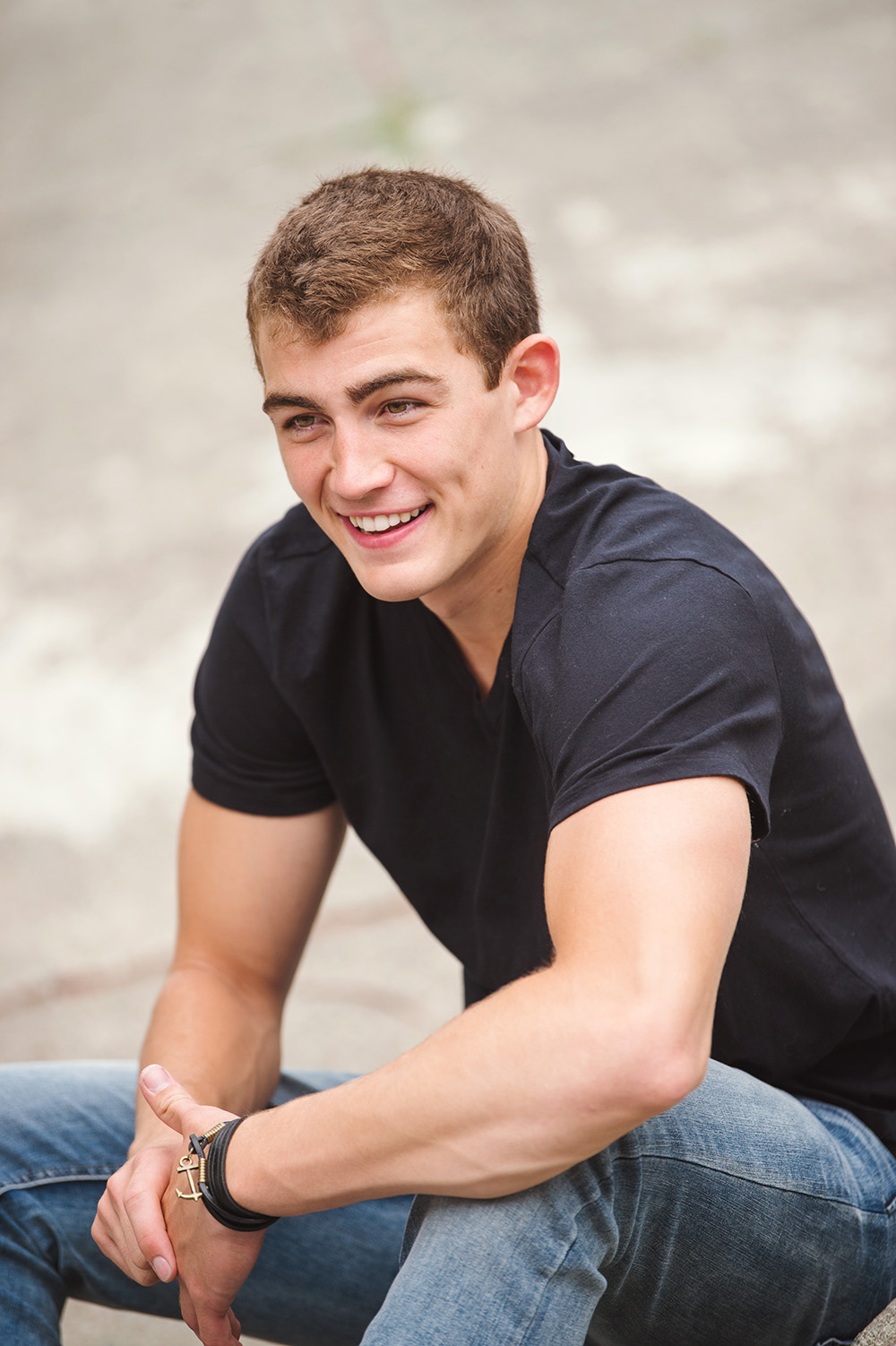 Great senior pictures of boy with dimples in black shirt_Studio B Portraits_Roorda.jpg