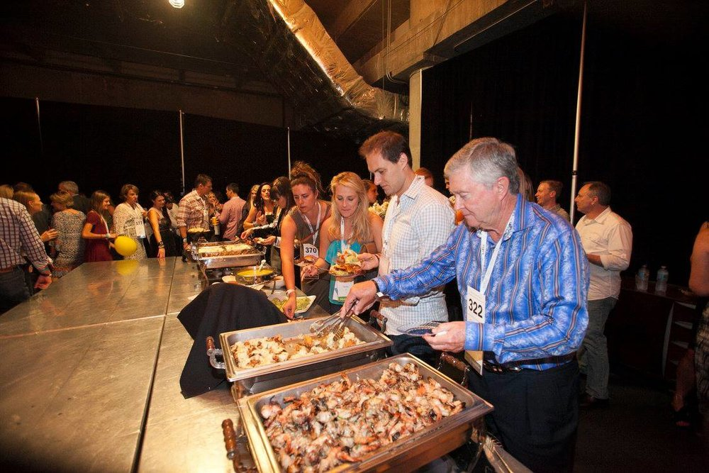 Attendees enjoying the food at the Give Hope after party, backstage at The Moody Theatre at ACL-Live