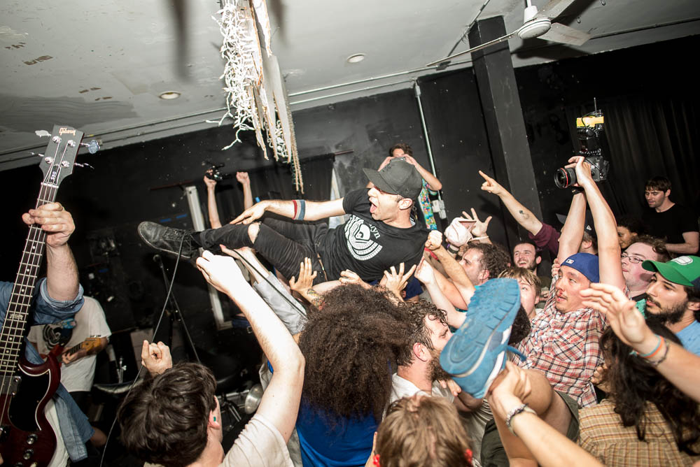 Alex of The So So Glos crowdsurfs