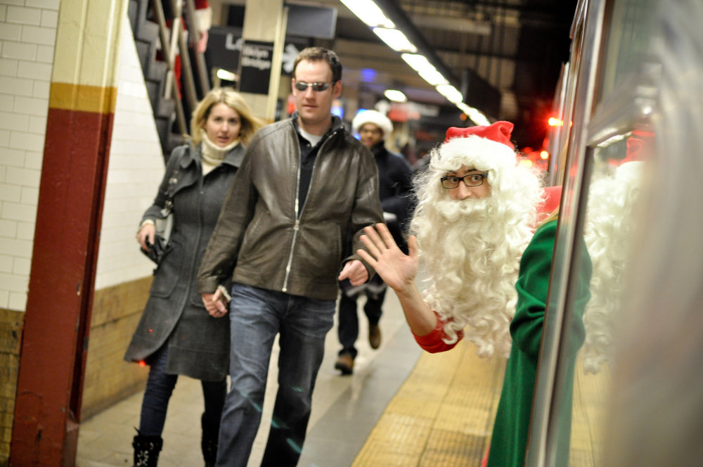 Santa on the 6 train during Santacon 2011.