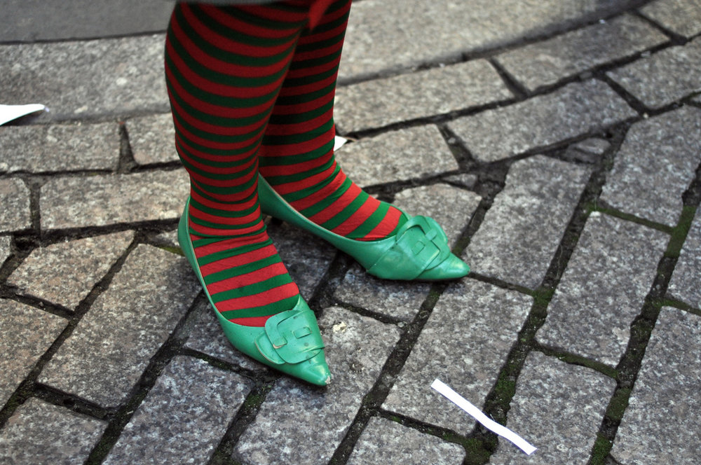 Red and green stockings and green shoes.