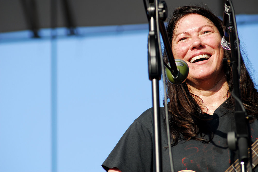 Kim Deal of  The Breeders  stands between her two microphones at McCarren Park Pool on Sunday, July 13, 2008.