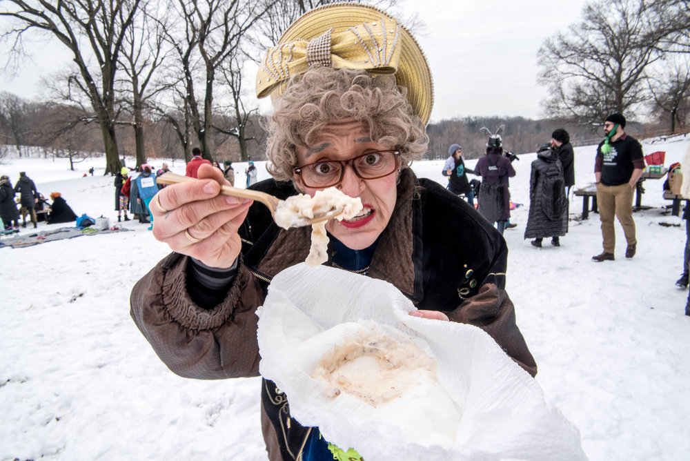 One of the Barely Legal Brunching Biddies team members offers rice pudding during Competitive Winter Picnicking on Saturday, March 2, 2019.