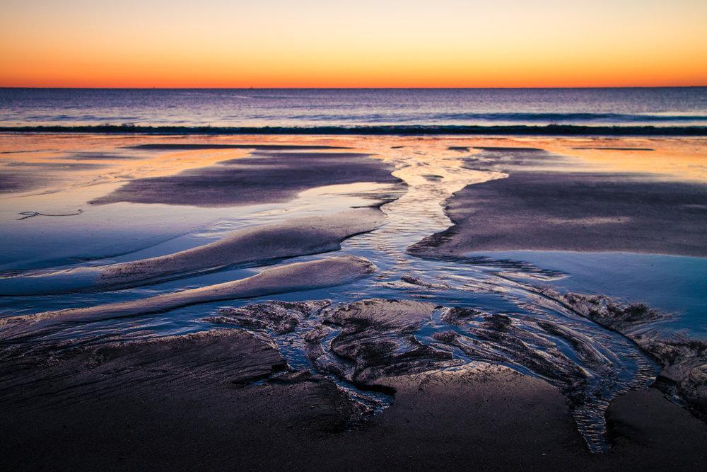 The sun rising over Tybee Island