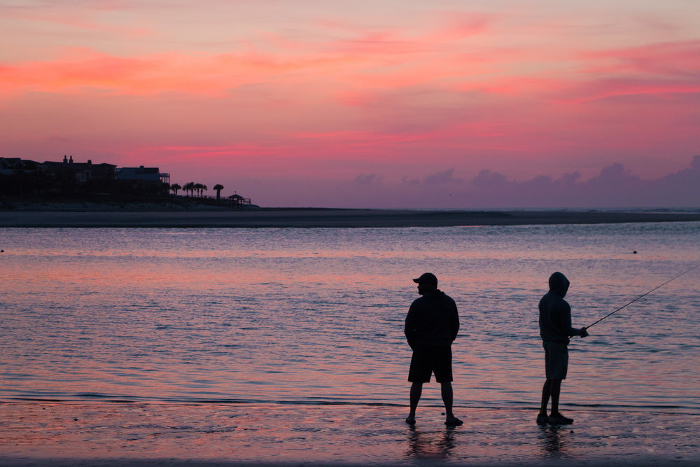 Two fishermen taking in the Easter morning sunrise on Sullivan's Island