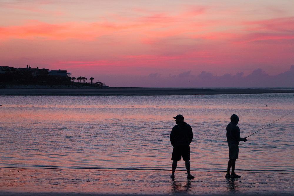 Two fishermen taking in the Easter morning sunrise on Sullivan's Island
