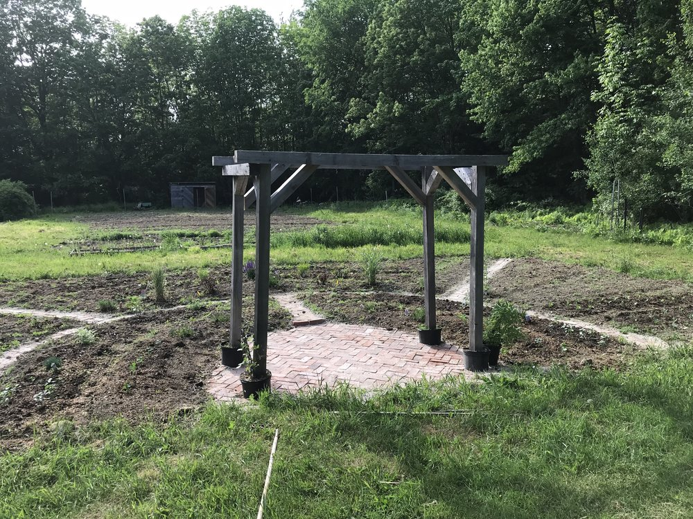The garden part isn't much to look at yet, but we laid the brick patio and paths ourself! This will be a beautiful spot for pictures or a small ceremony on the farm.