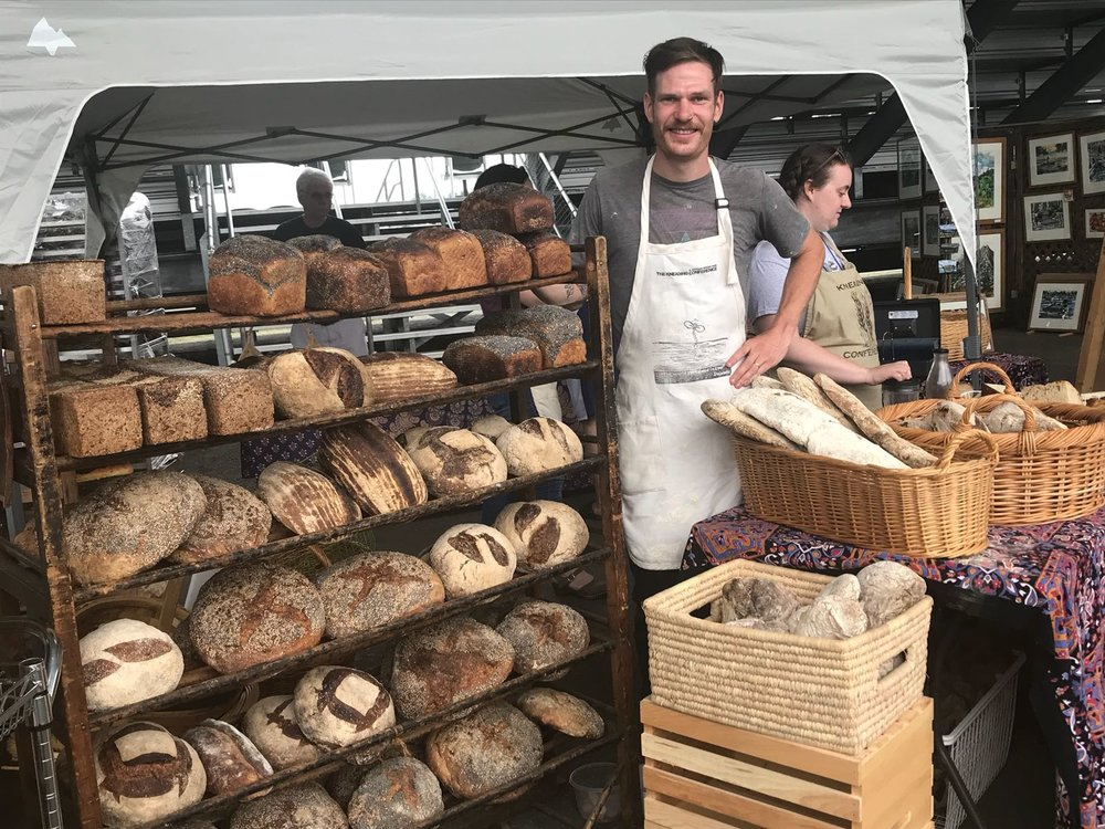 Brian at the Skowhegan Bread Fair selling loaves he baked at the Kneading Conference