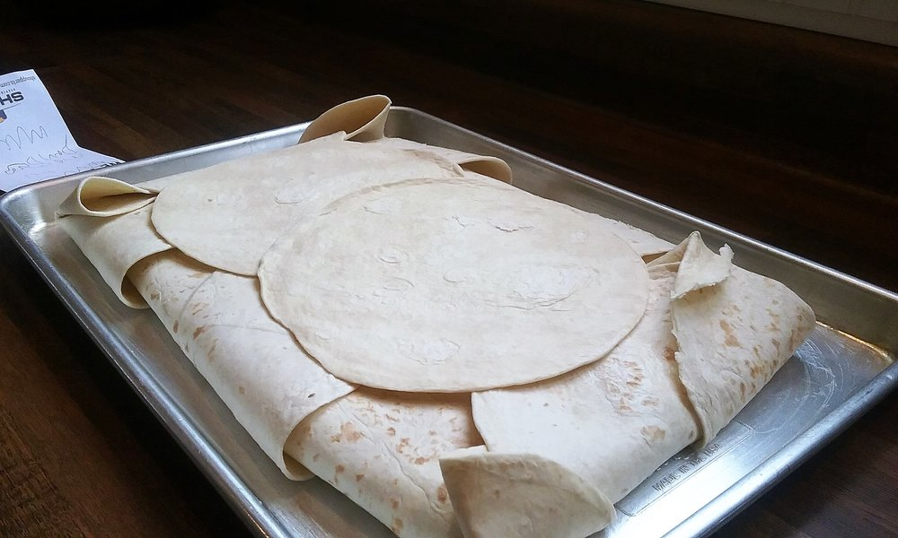 You can see from the above picture that the tortillas did not cover the middle, so just plop on a couple more and it will all be okay!